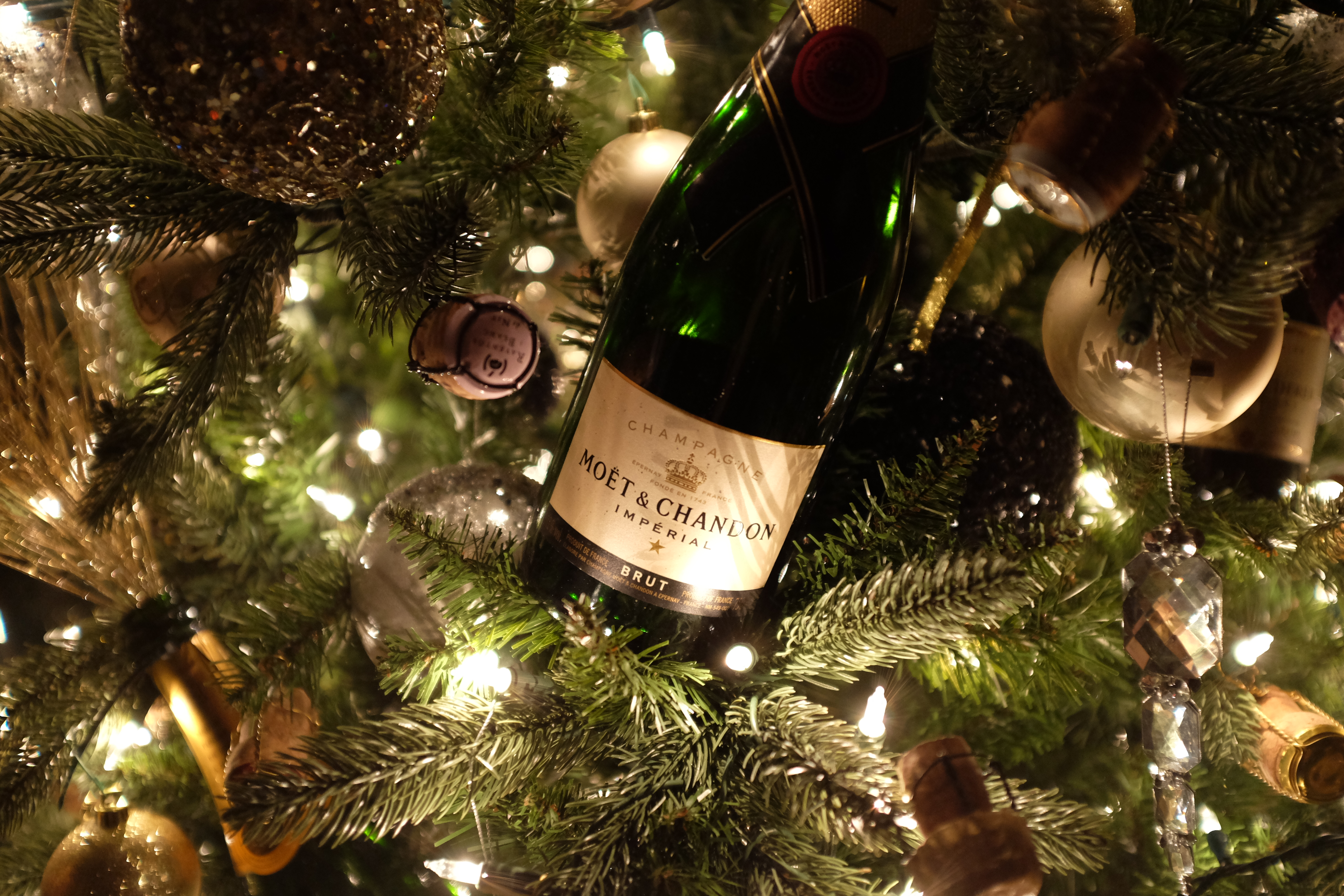 once the bottle is secure slide in your pick repeat for the rest of the bottles - How To Make A Wine Bottle Christmas Tree