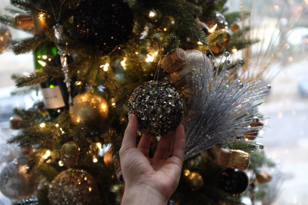 Your champagne related ornaments can help bring added dimension to your tree. Like this black and gold ball!